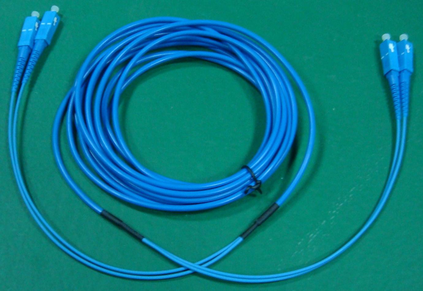 FO patch cord duplex armovaný 50/125 SC-SC 110m, OS2